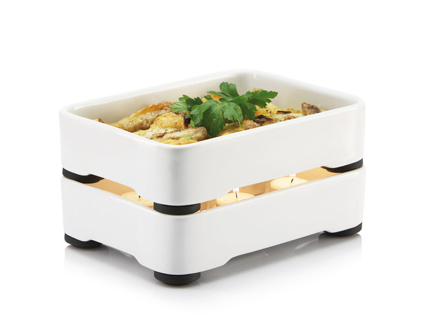 Stackable_oven-to-table_cookware_by_christian_bjorn_two_large_trays_with_food-sixhundred