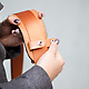 Classic Leather Camera Satchel holding the shoulder strap