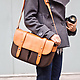 Classic Leather Camera Satchel standing with camera