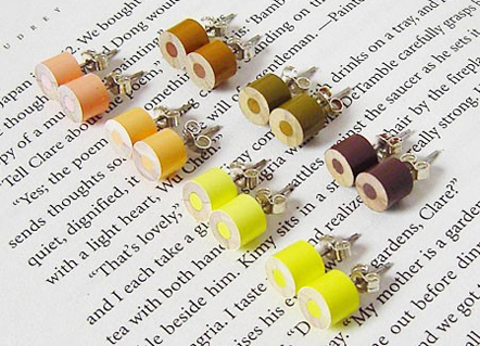 Color Pencil Stud Earrings by HuiYi Tan yellow set at an angle