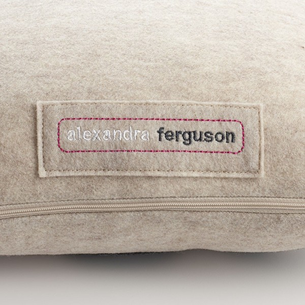 Lets_make_out_pillow_by_alexandra_ferguson_oatmeal_and_red_logo_detail-sixhundred