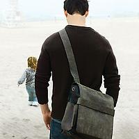 Leather Scout Rubicon Rucksack worn by a father at the beach with young daughter