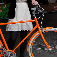 Public Orange D3 Bicycle with girl