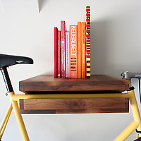 Knife & Saw Bike Shelf walnut with books and yellow bike